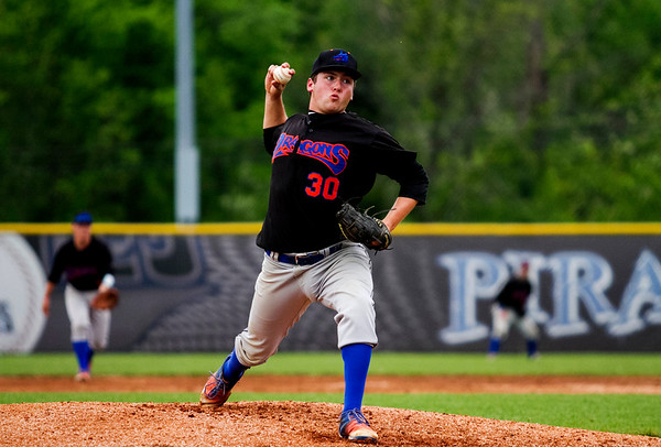 Silver Creek's Logan Murphy pitches during the Dragons' 11-2 win at Charlestown on Monday. Staff photo by Christopher Fryer