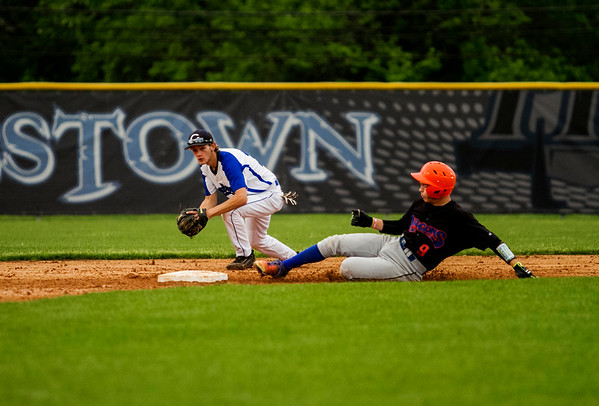 Silver Creek's Bryson McNay slides safely into second base on a double during the Dragons' 11-2 win at Charlestown on Monday. Staff photo by Christopher Fryer