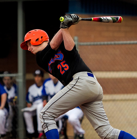 Silver Creek's Sam Hartsock connects for an RBI single during the Dragons' 11-2 win at Charlestown on Monday. Staff photo by Christopher Fryer