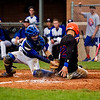Silver Creek's Justin Brown slides safely into home plate past Charlestown's Brett Blackford during the Dragons' 11-2 win over the Pirates Charlestown on Monday. Staff photo by Christopher Fryer