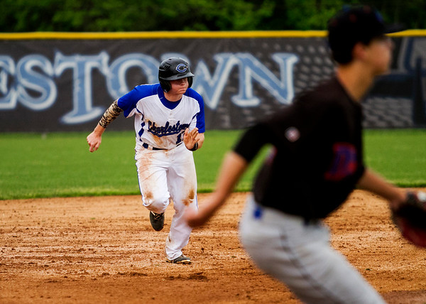 Charlestown's Brandon Love takes off for third base during the Pirates' 11-2 home loss to Silver Creek on Monday. Staff photo by Christopher Fryer