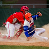 Silver Creek's Sam Hartsock slides safely into home off of a Tyler Wheeler bunt during the Dragons' game at Jeffersonville on Wednesday. Staff photo by Christopher Fryer