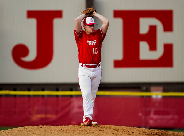 Jeffersonville's Ian Ellis pitches during the Red Devils' home game against Silver Creek on Wednesday. Staff photo by Christopher Fryer
