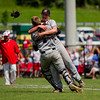 New Albany catcher Timmie Redford, left, tackles pitcher Chase Rudy in celebration after the Bulldogs' defeated Jeffersonville in the championship round of the Floyd Central Sectional on Monday in Floyds Knobs. Staff photo by Christopher Fryer