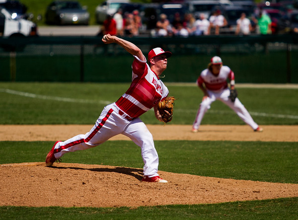 Jeffersonville senior Ian Ellis pitches during the Red Devils' 1-0 loss to New Albany in the championship round of the Floyd Central Sectional on Monday in Floyds Knobs. Staff photo by Christopher Fryer