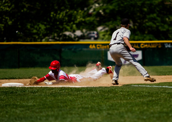 Jeffersonville junior Bennie Day slides safely into third base during the Red Devils' 1-0 loss to New Albany in the championship round of the Floyd Central Sectional on Monday in Floyds Knobs. Staff photo by Christopher Fryer