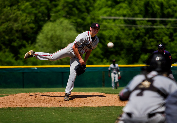 New Albany sophomore Chase Rudy pitches during the Bulldogs' 1-0 win over Jeffersonville in the championship round of the Floyd Central Sectional on Monday in Floyds Knobs. Staff photo by Christopher Fryer