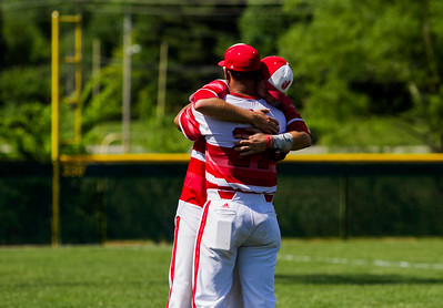 Jeffersonville junior Cameron Northern, left, consoles senior Joseph Burke following the Red Devils' 1-0 loss to New Albany in the championship round of the Floyd Central Sectional on Monday in Floyds Knobs. Staff photo by Christopher Fryer