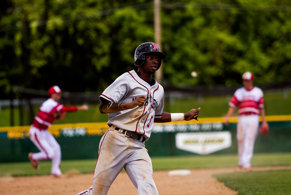 New Albany senior Alden Nixon makes it safely to third base during the Bulldogs' 1-0 win over Jeffersonville in the championship round of the Floyd Central Sectional on Monday in Floyds Knobs. Staff photo by Christopher Fryer