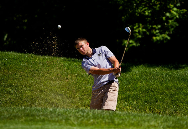 Providence senior Kevin Crone hits from a bunker on the 13th hole during the Providence Sectional at Covered Bridge Golf Club in Sellersburg on Monday. Staff photo by Christopher Fryer