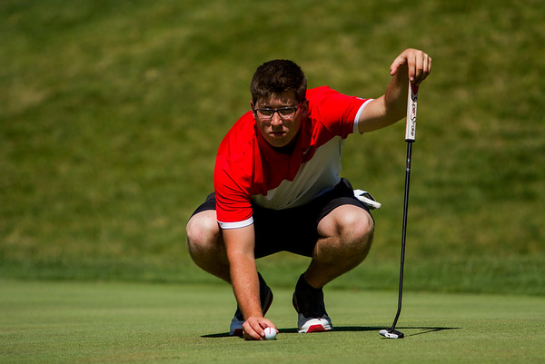 New Albany senior Addison Greenwell studies and lines up his putt on the 12th green during the Providence Sectional at Covered Bridge Golf Club in Sellersburg on Monday. Staff photo by Christopher Fryer