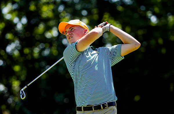 Floyd Central senior David Shepard hits from the 13th fairway during the Providence Sectional at Covered Bridge Golf Club in Sellersburg on Monday. Staff photo by Christopher Fryer