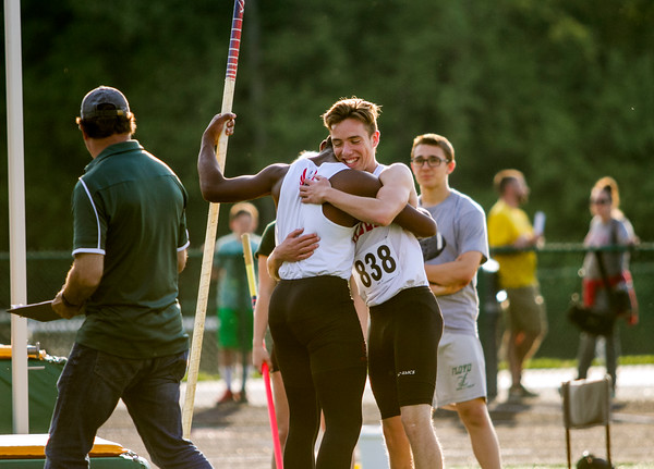 New Albany sophomore Travis Miller, right, congratulates freshman Koran Givens after he cleared the bar while competing in the pole vault during the Floyd Central Sectional in Floyds Knobs on Thursday. Staff photo by Christopher Fryer