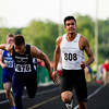 Floyd Central junior Antonio Villegas finishes first in the 100-meter dash during the Floyd Central Sectional in Floyds Knobs on Thursday. Staff photo by Christopher Fryer