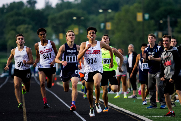 Runners approach the finish line during the 800-meter run at the Floyd Central Floyd Central Sectional in Floyds Knobs on Thursday. Staff photo by Christopher Fryer