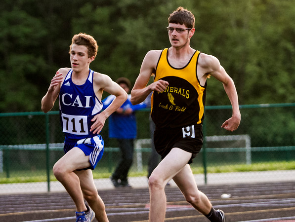 Clarksville senior Stuart Martin, right, and Christian Academy of Indiana freshman Evan Heitz compete in the 800-meter run at the Floyd Central Floyd Central Sectional in Floyds Knobs on Thursday. Staff photo by Christopher Fryer