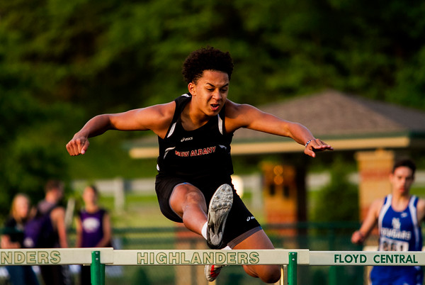 New Albany freshman Devon Gummer clears a hurdle during the 300-meter hurdles at the Floyd Central Sectional in Floyds Knobs on Thursday. Staff photo by Christopher Fryer