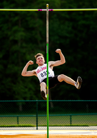 New Albany sophomore Travis Miller celebrates after clearing the bar while competing in the pole vault during the Floyd Central Sectional in Floyds Knobs on Thursday. Staff photo by Christopher Fryer