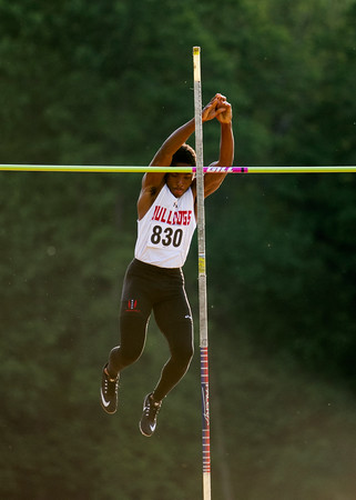 New Albany freshman Koran Givens clears the bar while competing in the pole vault during the Floyd Central Sectional in Floyds Knobs on Thursday. Staff photo by Christopher Fryer