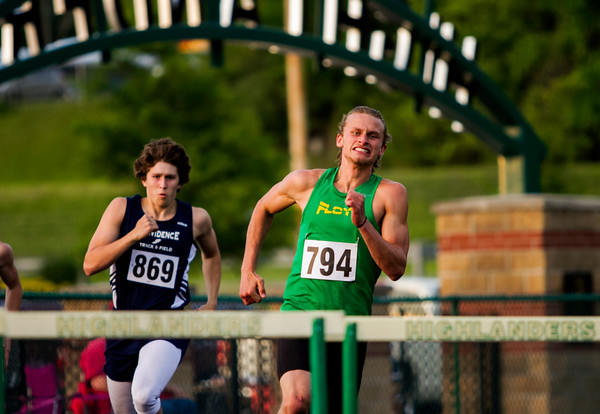 Floyd Central junior Brad Foster, right, and Providence freshman Bryce Drury compete in the 300-meter hurdles during the Floyd Central Sectional in Floyds Knobs on Thursday. Staff photo by Christopher Fryer