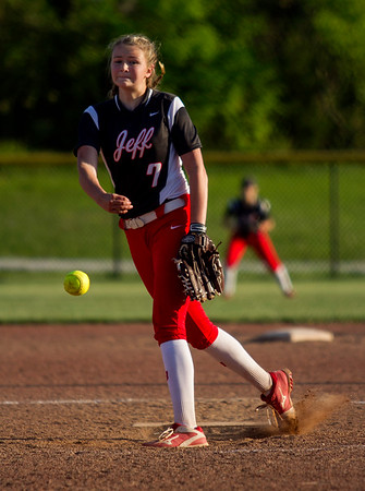 Jeffersonville's Lizzie Coons pitches during the Red Devils' 12-2 loss in five innings at New Albany on Monday. Staff photo by Christopher Fryer