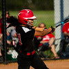 New Albany's Terah Crosier connects for a two-run RBI triple during the Bulldogs' 12-2 home win in five innings over Jeffersonville on Monday. Staff photo by Christopher Fryer