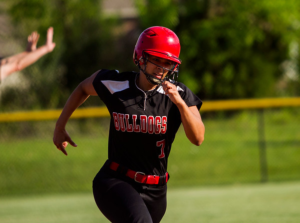New Albany's Kennedy Wynn approaches home plate to score during the Bulldogs' 12-2 home win in five innings over Jeffersonville on Monday. Staff photo by Christopher Fryer
