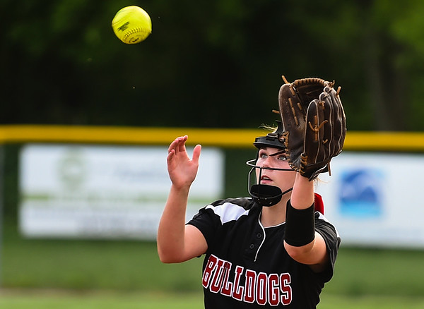 New Albany pitcher Bri Schoenfeld catches a short fly ball off the mound during the Bulldogs 5-0 loss to Floyd Central in the semifinal of the Hoosier Hills Conference tournament Wednesday night. Staff photo by Tyler Stewart