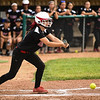 New Albany designated hitter Alyssa Kraemer lays down a bunt to move runners, loading the bases, during the Bulldogs' 5-0 loss to Floyd Central in the semifinal of the Hoosier Hills Conference tournament Wednesday night. Staff photo by Tyler Stewart