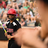 New Albany third baseman Kennedy Wynn gets advice from an assistant coach before batting during New Albany's 5-0 loss to Floyd Central in the semifinal of the Hoosier Hills Conference tournament Wednesday night. Staff photo by Tyler Stewart