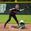Floyd Central leftfielder Taylor Castleberry dives to beat the throw to New Albany shortstop Mariah Grant during the Highlanders' 5-0 win over the Bulldogs in the semifinal of the Hoosier Hills Conference tournament Wednesday night. Staff photo by Tyler Stewart
