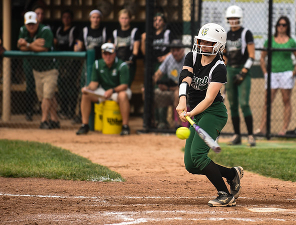 Floyd Central second baseman Paige Meyer connects with the ball during the Highlanders' 5-0 win over New Albany in the semifinal of the Hoosier Hills Conference tournament Wednesday night. Staff photo by Tyler Stewart