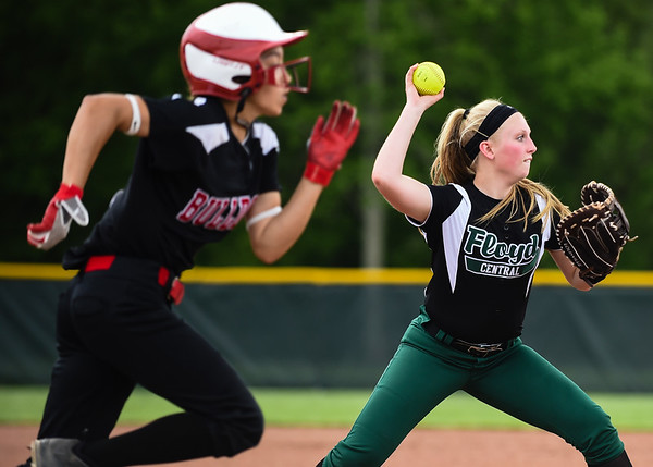Floyd Central first baseman Kassie King makes the throw to first after fielding a ground ball by New Albany shortstop Mariah Grant during the Highlanders' 5-0 win over the Bulldogs in the semifinal of the Hoosier Hills Conference tournament Wednesday night. Staff photo by Tyler Stewart