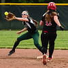 Floyd Central shortstop Gabbi Jenkins fields the throw to second base to stop the advancement of New Albany first baseman Riley Case during the Highlanders' 5-0 win over the Bulldogs in the semifinal of the Hoosier Hills Conference tournament Wednesday night. Staff photo by Tyler Stewart