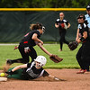 Floyd Central leftfielder Taylor Castleberry beats the New Albany throw to second for her second stolen base during the Highlanders' 5-0 win over the Bulldogs in the semifinal of the Hoosier Hills Conference tournament Wednesday night. Staff photo by Tyler Stewart