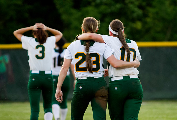 Floyd Central seniors Gabbi Jenkins, left, and Maddie Probus console each other following the Highlanders' 1-0 loss to Gibson Southern at the Floyd Central Regional in Floyds Knobs on Tuesday. Staff photo by Christopher Fryer