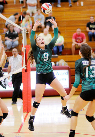 Don Knight   The Herald Bulletin<br /> Pendleton Heights Rachel Axsom passes the ball as the Arabians faced the Madison-Grant Argylls during the county volleyball tournament at Elwood on Saturday.