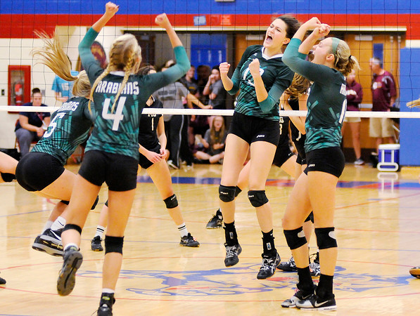Don Knight   The Herald Bulletin<br /> Madison-Grant wins the county volleyball tournament at Elwood on Saturday.