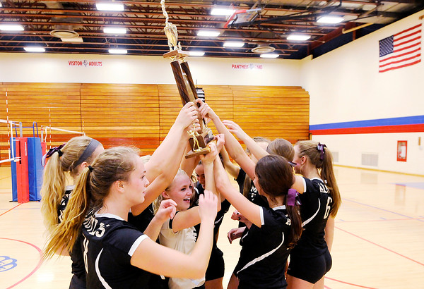Don Knight | The Herald Bulletin<br /> The Madison-Grant Argylls hoist the county trophy in the air after winning the county volleyball tournament at Elwood on Saturday.