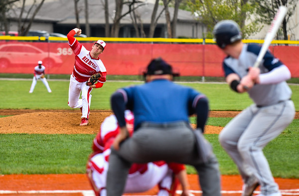 Jeffersonville pitcher Jacob Cochran throws to the Decatur Central batter during the Red Devils' loss to the Hawks on Friday. Staff photo by Tyler Stewart