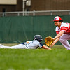 Jeffersonville first baseman Hunter Schmitz readies to catch the ball during an attempted pick-off throw during the Red Devils' loss to Decatur Central on Friday. Staff photo by Tyler Stewart