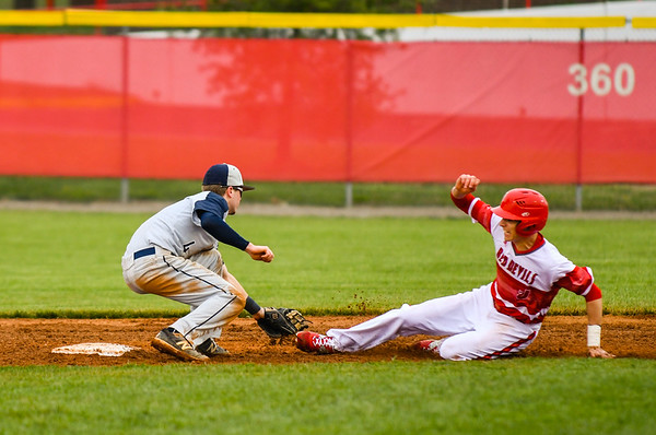 Jeffersonville's Gabe Bierman is tagged by Decatur Central's Parker Harrington after attempting to steal second base during the Red Devils' loss to the Hawks on Friday. Staff photo by Tyler Stewart