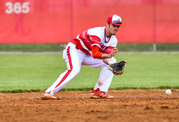 Jeffersonville shortstop Michael Minton fields a ground ball during the Red Devils' loss to Decatur Central on Friday. Staff photo by Tyler Stewart