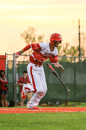 Jeffersonville's Michael Minton drops his bat and heads for first base during the Red Devils' game against New Albany on Wednesday. Staff Photo By Josh Hicks