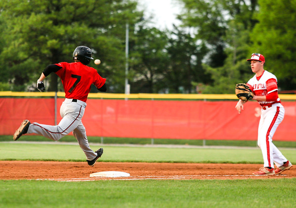 New Albany's Chase Ruoy beats the ball, landing safely on first during the Bulldogs' game against Jeffersonville on Wednesday. Staff Photo By Josh Hicks