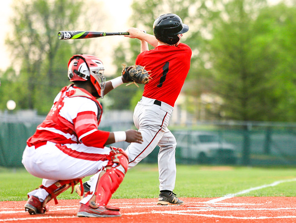 New Albany's Logan Charbonneau swings and misses as Jeffersonville's Devin Rivers catches the strike. Staff Photo By Josh Hicks
