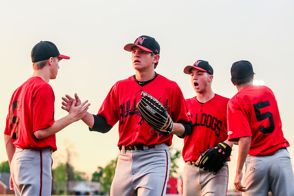 From left, New Albany's Jacob Prince, Chase Ruoy, Dylan Clark, and Jason Jeter exchange high fives as the Bulldogs head back to the dug out and get ready for bat. Staff Photo By Josh Hicks