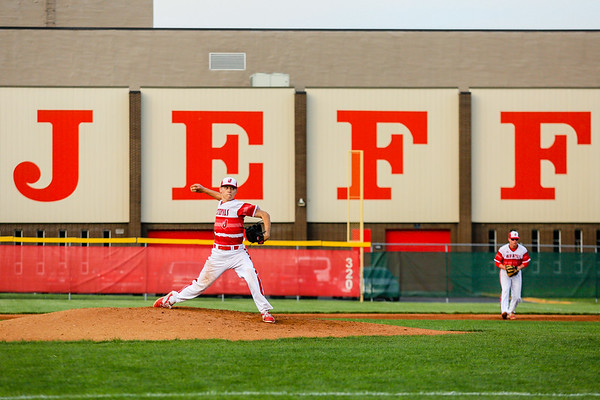 Jeffersonville's Gabe Bierman throws a pitch during the Red Devils' game against New Albany on Wednesday. Staff Photo By Josh Hicks