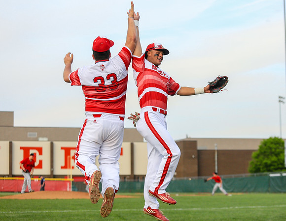 Jeffersonville's Ian Francisco, left, and Cameron Northern jump to give each other a high five during the Red Devils' game against New Albany on Wednesday. Staff Photo By Josh Hicks