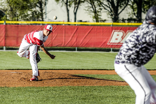 Jeffersonville's Gabe Bierman throws a pitch during the Red Devils' game against Seymour on Thursday. Staff Photo By Josh Hicks